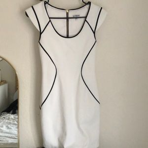 White Express dress with navy blue detail.